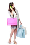 Woman with shopping bags using cellphone Stock Image