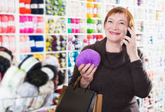 Woman with shopping bags using phone Royalty Free Stock Image