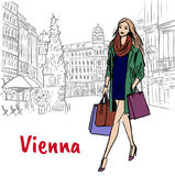 Woman with shopping bags in Vienna Stock Photography