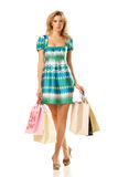 Woman with shopping bags walking Royalty Free Stock Photos