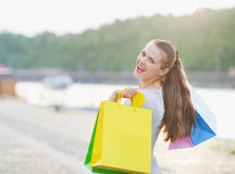 Woman with shopping bags walking embankment Royalty Free Stock Photography