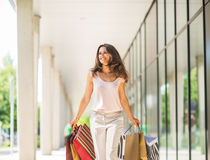 Woman with shopping bags walking on the mall Royalty Free Stock Photos