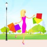 Woman shopping bags walking park outdoor vector Royalty Free Stock Photos