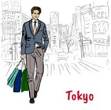Woman in Tokyo. Woman with shopping bags walking on street in Shibuya, Tokyo, Japan Royalty Free Stock Image