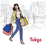 Woman in Tokyo. Woman with shopping bags walking on street in Shibuya, Tokyo, Japan Stock Images