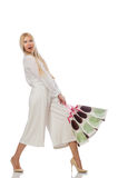The woman with shopping bags on white Royalty Free Stock Photos