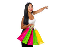 The woman with shopping bags on white Royalty Free Stock Images