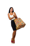 The woman with shopping bags on white Royalty Free Stock Image