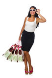 Woman with shopping bags on white Stock Photos