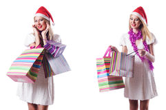 The woman with shopping bags  on white Stock Photo