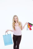 Woman with shopping bags on a white background Royalty Free Stock Images