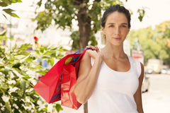 Woman with shopping bags. Young woman with shopping bags Royalty Free Stock Photography