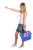 Woman with shopping basket royalty free stock photo
