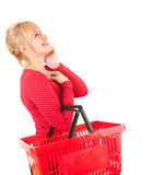 Woman with shopping basket looking up Royalty Free Stock Photos