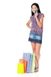 Woman shopping. Beautiful young woman with shopping bags showing credit card or gift card, isolated over white background Stock Images