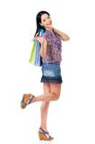 Woman shopping. Beautiful young woman with shopping bags showing credit card or gift card, isolated over white background Stock Image
