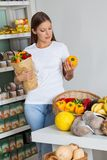 Woman Shopping Bellpeppers In Supermarket Stock Photo