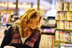 Woman shopping in bookstore stock photo