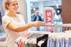 Woman shopping in a boutique stock images