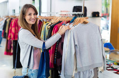 Woman shopping in a boutique Royalty Free Stock Photos