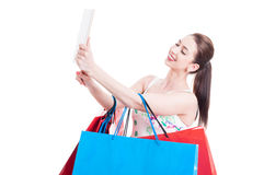 Woman at shopping with bunch of bags taking selfie Royalty Free Stock Image