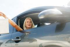 Woman with shopping in car. Photo of woman with shopping in car at summer day Stock Photos