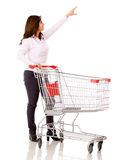 Woman with a shopping cart Royalty Free Stock Image