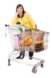 Woman with shopping cart Royalty Free Stock Image