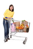 Woman with shopping cart royalty free stock images