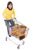 Woman with shopping cart Stock Photos