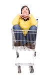 Woman with shopping cart Royalty Free Stock Photos