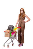 The woman with shopping cart and bags isolated on white Royalty Free Stock Photos