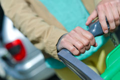 Woman with shopping cart on car parking Stock Photo
