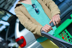 Woman with shopping cart on car parking Royalty Free Stock Photography