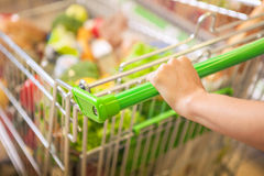 Woman with shopping cart. Stock Photography