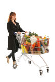 Woman with Shopping cart full dairy grocery Royalty Free Stock Image