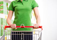 Woman with shopping cart Royalty Free Stock Photo