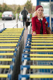 Woman with shopping carts Royalty Free Stock Image