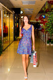 Woman in shopping center Stock Images