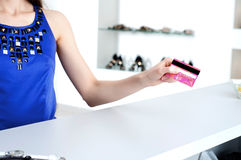 Woman at shopping checkout paying credit card Royalty Free Stock Photo