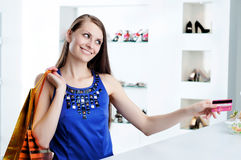 Woman at shopping checkout paying credit card Royalty Free Stock Photos