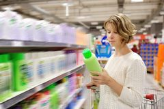 Woman shopping and choosing goods at supermarket Royalty Free Stock Photography