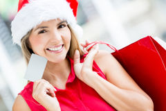 Woman shopping for Christmas Stock Photos