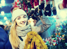 Woman shopping at Christmas fair before Xmas in evening time Royalty Free Stock Images