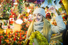 Woman shopping at Christmas fair before Xmas in evening time Stock Photo
