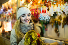 Woman shopping at Christmas fair before Xmas in evening time Royalty Free Stock Photography
