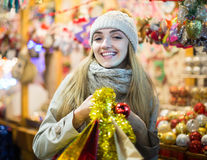 Woman shopping at Christmas fair before Xmas in evening time Stock Photography