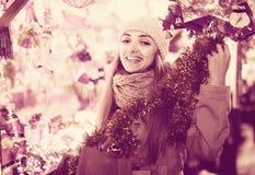 Woman shopping at Christmas fair before Xmas in evening time Stock Photos