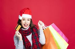 Woman shopping for christmas gifts by credit card Stock Photography
