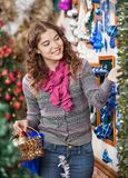 Woman Shopping For Christmas Ornaments Stock Photo